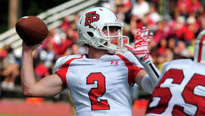 Fairfield Prep QB Colton Smith gets ready to throw a pass, during high school football action against St. Joseph in Trumbull, Conn., on Saturday Sept. 20, 2014.