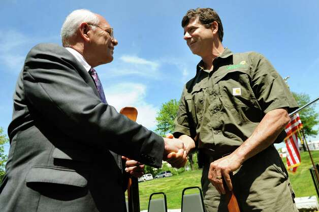 Rep. Paul Tonko, left, congratulates retired Col. Thom Besch, who started up Veteran Solar Systems Inc., on Wednesday, May 14, 2014, at Erie Canal Side Cut Park in Watervliet, N.Y. The event announced the establishment of The Michael R. McNulty Center for Veteran Entrepreneurial Activity at the Watervliet Arsenal. (Cindy Schultz / Times Union) Photo: Cindy Schultz / 00026885A