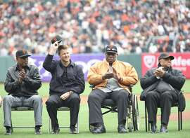 Giants' MVPs, left to right, Kevin Mitchell, Jeff Kent, Willie McCovey, and Willie Mays attend the award ceremony for Buster Posey the 2012 MLB MVP in San Francisco, on Saturday, April 6, 2013.