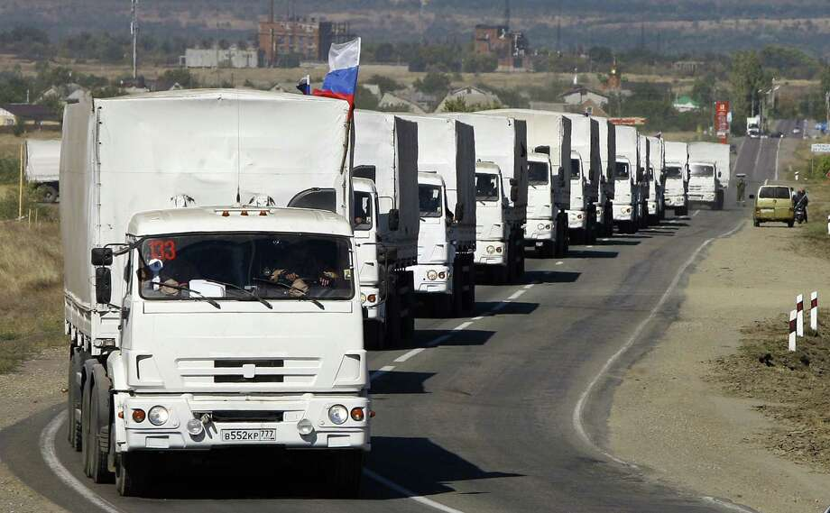 Lorries, part of a Russian humanitarian convoy, approach the Ukrainian border at the Donetsk-Izvarino border checkpoint onFriday. Photo: SERGEI VENYAVSKY, Stringer / AFP