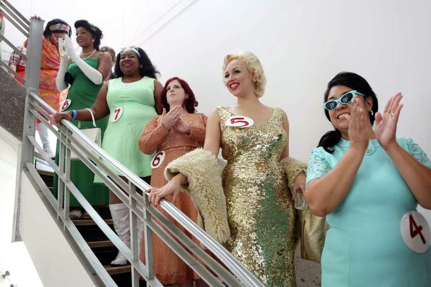 Houston Vintage Beauty Pageant contestants are introduced to the judges and the audience during the Houston Vintage Show held at the 1940 Air Terminal Museum on Saturday, Sept. 20, 2014, in Houston.
