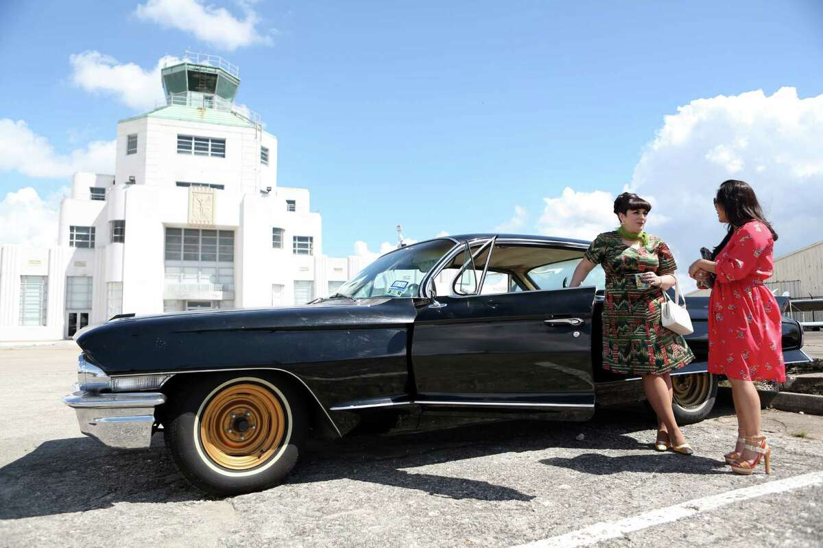 Natty D'Light shows her Cadillac Series '62 to designer and judge Chloe Dao outside the Houston Vintage Show held at the 1940 Air Terminal Museum on Saturday, Sept. 20, 2014, in Houston.