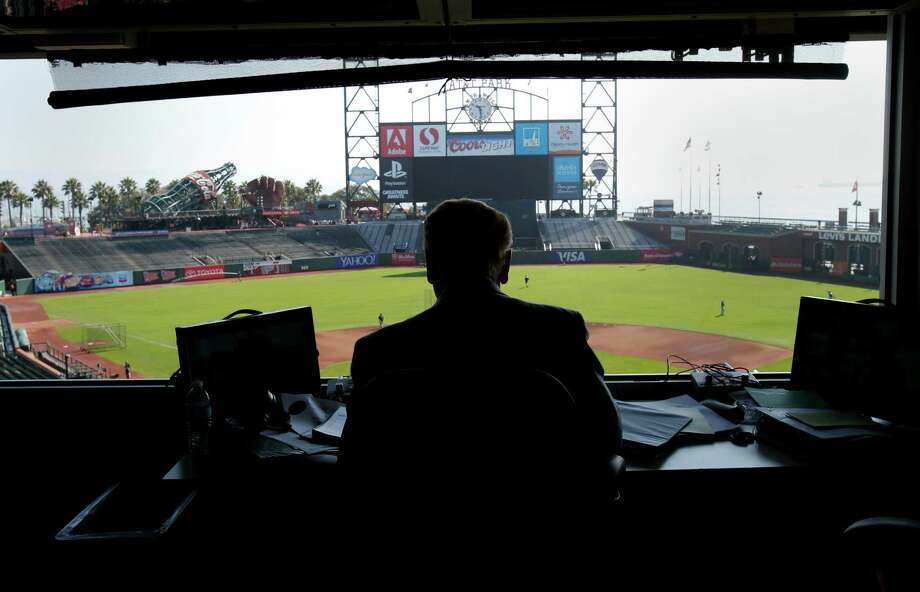 Vin Scully, above, finishes preparations to broadcast the Dodgers' game against the Giants on Sept. 14 at AT&T Park. Scully, smiling at a colleague's comment, below, was a Giants fan in his youth but has been working Dodgers games for 65 years. Photo: Brant Ward, Staff Photographer / The Chronicle / ONLINE_YES