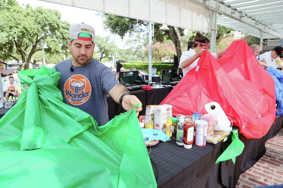Chef Kevin Naderi reveals ingredients, limited food items found in emergency kits, during the second annual Ready Houston Preparedness Kit Chef's Challenge at Market Square on Saturday, Sept. 20, 2014, in Houston. The event was hosted by The City of Houston Mayor's Office of Public Safety and Homeland Security, and Houston Community Preparedness Collaborative.