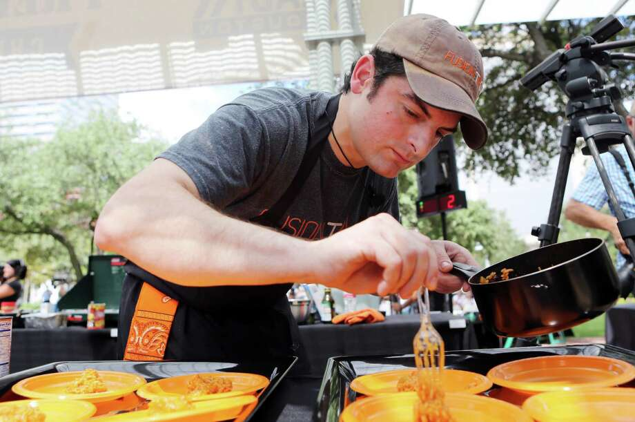 Chef David Grossman plates his dish during the second annual Ready Houston Preparedness Kit Chef's Challenge at Market Square on Saturday, Sept. 20, 2014, in Houston. The event was hosted by The City of Houston Mayor's Office of Public Safety and Homeland Security, and Houston Community Preparedness Collaborative. Photo: Mayra Beltran, Houston Chronicle / © 2014 Houston Chronicle