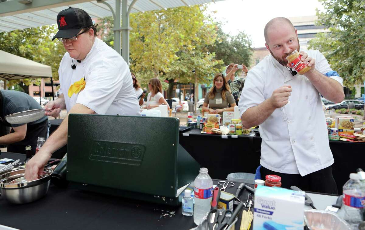 Chef Jonathan Jones and Chef Travis Lenig start to prepare their dish made from limited food items found in emergency kits during the second annual Ready Houston Preparedness Kit Chef's Challenge at Market Square on Saturday, Sept. 20, 2014, in Houston. The event was hosted by The City of Houston Mayor's Office of Public Safety and Homeland Security, and Houston Community Preparedness Collaborative.