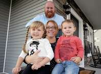 Tyler Minehan with his wife Jennifer Minehan and their two children Luke,2-years-old, and Grace, 5-years-old, on  Thursday Sept. 18, 2014 in Malta, N.Y. (Michael P. Farrell/Times Union)