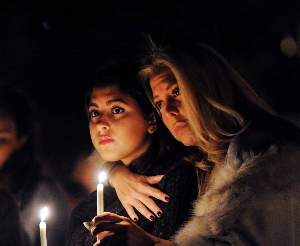 Sonia Hedvat of Greenwich, right, hugs her daughter, Brigitte, 16, during the candlelight vigil in memory of Emily Fedorko near the Arch Street Teen Center in Greenwich, Conn., Saturday night, Sept. 20, 2014. Fedorko, a Greenwich teenager, who was going to start her junior year at Greenwich High School, lost her life in a boating accident in the water off Greenwich Point on August 6. Brigitte Hedvat is a junior at Greenwich High School and was a friend of Emily's.
