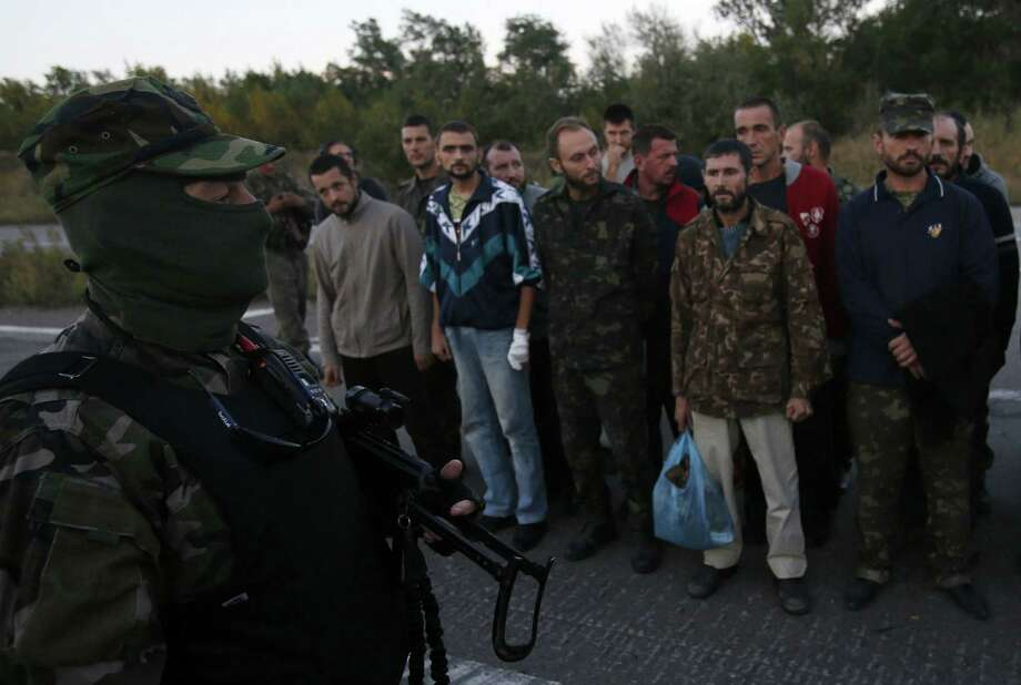 A Ukrainian officer speaks with prisoners of war during a prisoner exchange in eastern Ukraine. A top NATO official blasted the cease-fire as ineffective. Photo: Associated Press / AP