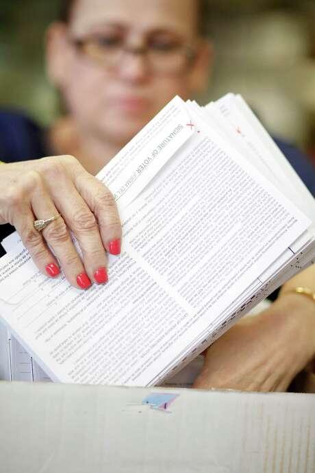 Election clerk Sonia Salinas sends out ballots by mail Friday. Photo: Eric Kayne / Eric Kayne