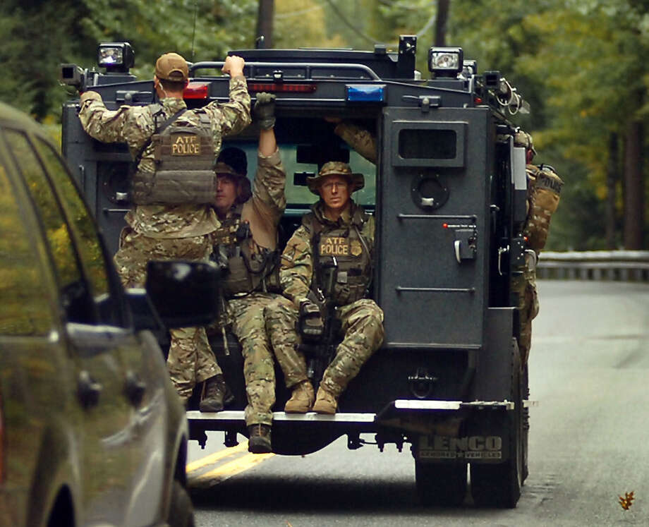 Bureau of Alcohol, Tobacco, Firearms and Explosives members are searching Price Township on Saturday near Canadensis, Pa., for suspected killer Eric Frein. Photo: Butch Comegys / Scranton Times & Tribune / The Scranton Times & Tribune