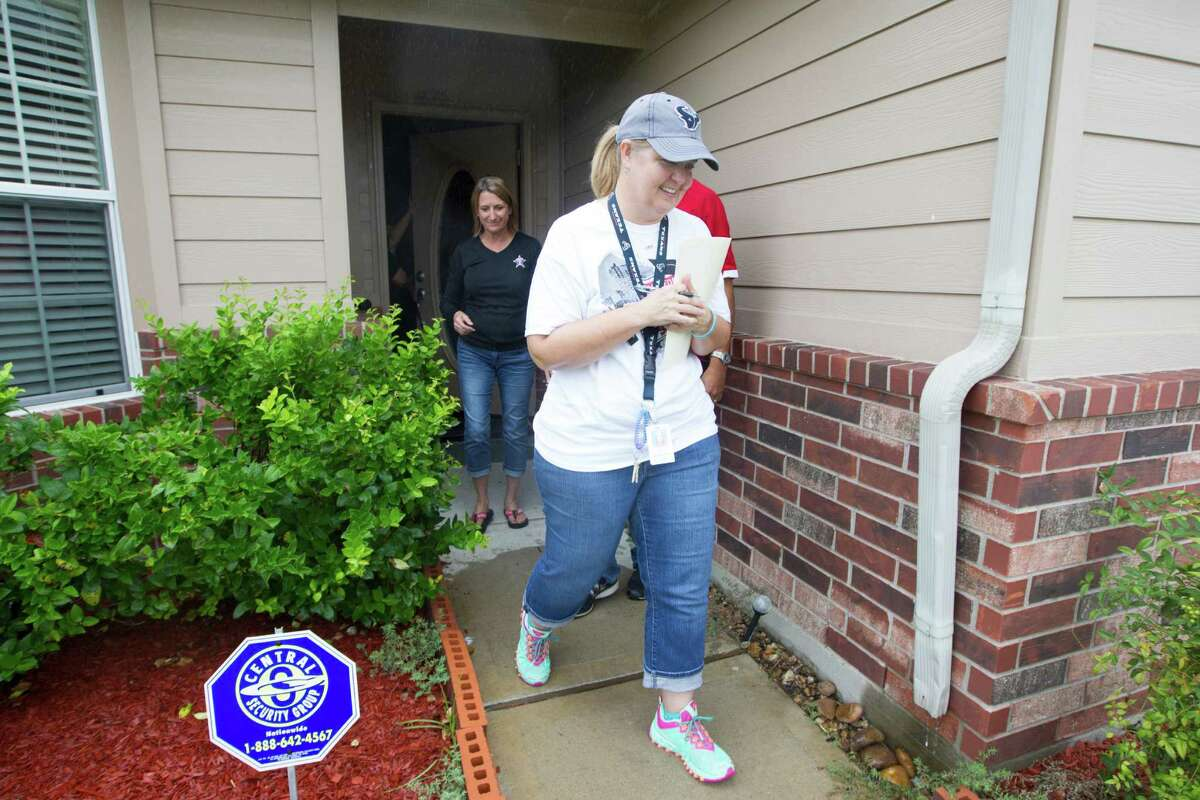 Lamar CISD social worker Dawn Byrd and Terry High School Principle Vera Wehring walk the streets in a organized dropout walk to reach out to students who didn't return on Saturday, Sept. 13, 2014, in Rosenberg.