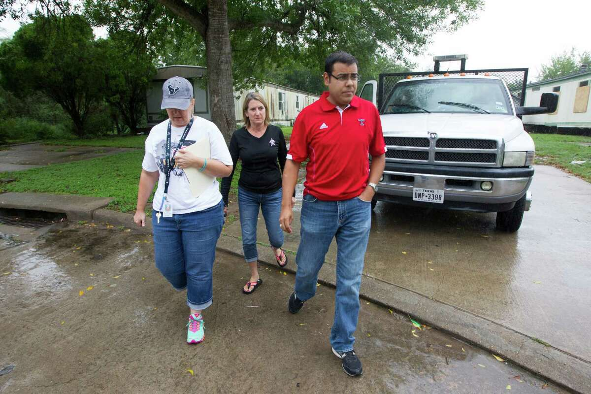 Lamar CISD social worker Dawn Byrd, Terry High School Principle Vera Wehring, and Assistant Principle Joey Pineda walk the streets in a organized dropout walk to reach out to students who didn't return on Saturday, Sept. 13, 2014, in Rosenberg.