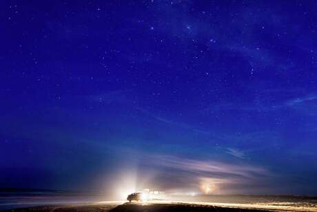 Stars come out, and lightning strikes, over Boca Chica Beach in Brownsville last month after SpaceX and the state of Texas announced that Elon Musk's rocket company will build a spaceport at the site in South Texas.