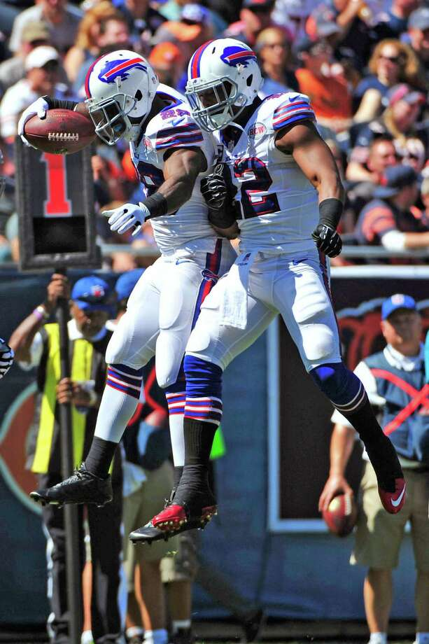 CHICAGO, IL - SEPTEMBER 07: C.J. Spiller #28 of the Buffalo Bills celebrates his first quarter touchdown with Fred Jackson #22 of the Buffalo Bills on September 7, 2014 at Soldier Field in Chicago, Illinois.  (Photo by David Banks/Getty Images) ORG XMIT: 504229829 Photo: David Banks / 2014 Getty Images