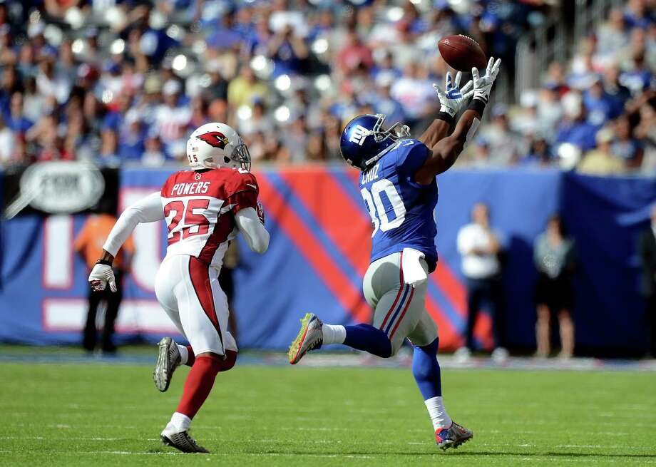 EAST RUTHERFORD, NJ - SEPTEMBER 14: Wide receiver Victor Cruz #80 of the New York Giants fails to make a catch as cornerback Jerraud Powers #25 of the Arizona Cardinals defends during a game at MetLife Stadium on September 14, 2014 in East Rutherford, New Jersey.  (Photo by Ron Antonelli/Getty Images) ORG XMIT: 504251767 Photo: Ron Antonelli / 2014 Getty Images