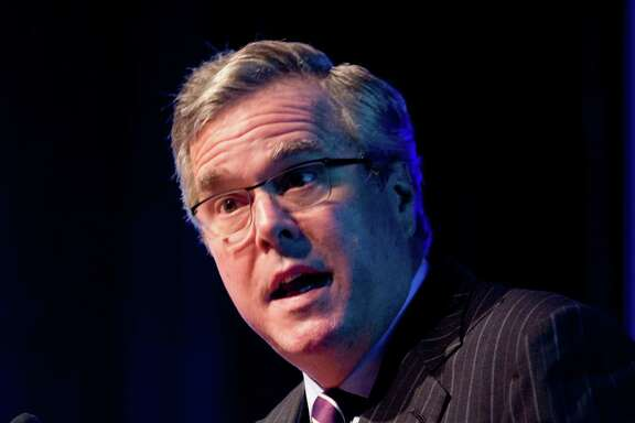 FILE- In this Jan. 29, 2014 file photo, former Florida Gov. Jeb Bush gestures as he speaks at a conference in Hollywood, Fla. Bush is tending to his growing business empire while other Republicans mulling the 2016 presidential race are laying the foundations of their potential campaigns.  (AP Photo/Wilfredo Lee, File)