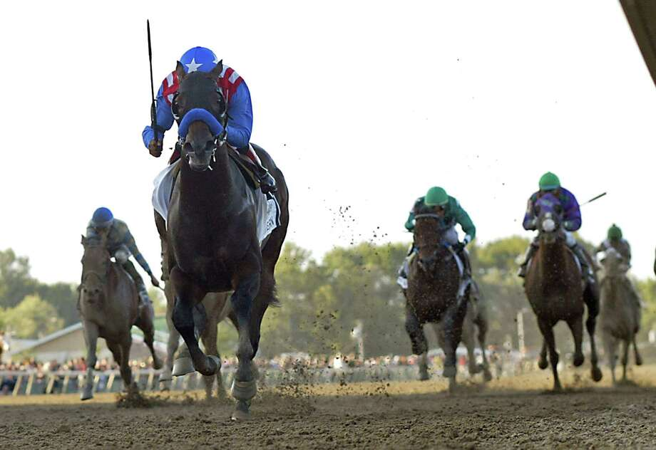 In this image provided by Equi-Photo, Bayern, with Martin Garcia aboard, runs on its way to winning the Pennsylvania Derby horse race at Parx Racing in Bensalem, Pa., Saturday, Sept. 20, 2014. (AP Photo/Equi-Photo, Bill Denver) ORG XMIT: PPR107 Photo: Bill Denver / Equi-Photo