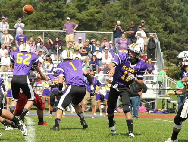 Voorheesville's Robert Denman fires a pass during their boy's high school football game against Mechanicville on Saturday Sept. 20, 2014 in Voorheesville, N.Y.  (Michael P. Farrell/Times Union) Photo: Michael P. Farrell / 00028673A