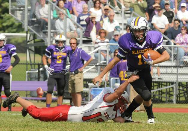 Voorheesville's Robert Denman is slowed down on a run by  Donevan Mysliwiec during their boy's high school football game on Saturday Sept. 20, 2014 in Voorheesville, N.Y.  (Michael P. Farrell/Times Union) Photo: Michael P. Farrell / 00028673A
