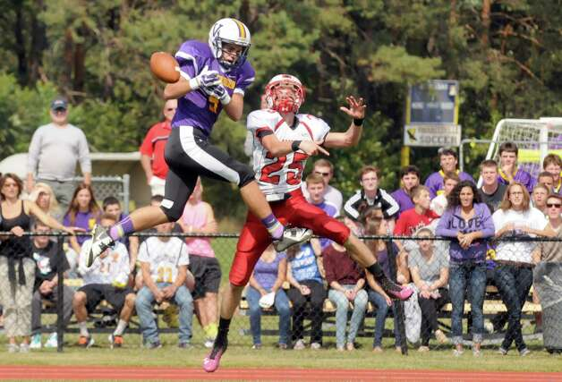 Voorheesville's Shane Perry can't hang on to a pass defended by Mechanicville's Colin Jachna during their boy's high school football game against Mechanicville on Saturday Sept. 20, 2014 in Voorheesville, N.Y.  (Michael P. Farrell/Times Union) Photo: Michael P. Farrell / 00028673A