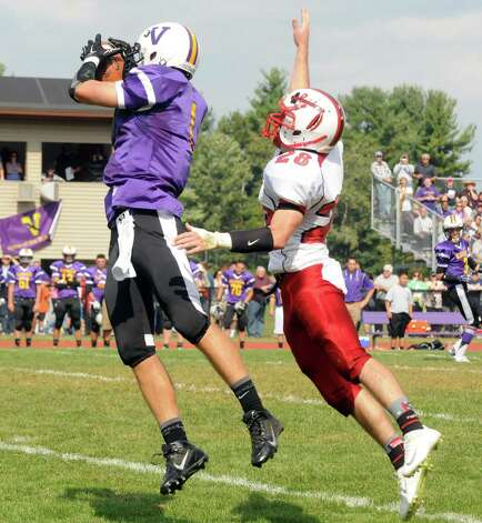 Voorheesville's Scott Roney catches a pass defended by Mechanicville's Jacob Henes during their boy's high school football game against Mechanicville on Saturday Sept. 20, 2014 in Voorheesville, N.Y.  (Michael P. Farrell/Times Union) Photo: Michael P. Farrell / 00028673A