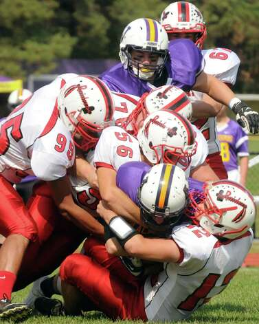 Voorheesville's Robert Denman is wraped up on a run during their boy's high school football game against Mechanicville on Saturday Sept. 20, 2014 in Voorheesville, N.Y.  (Michael P. Farrell/Times Union) Photo: Michael P. Farrell / 00028673A