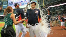Collin McHugh is doused by Astros teammates during his TV interview as the team celebrates its 5-1 win over the A's at Minute Maid Park on April 27. McHugh finished with one run allowed on two hits and three walks in 82⁄3 innings.