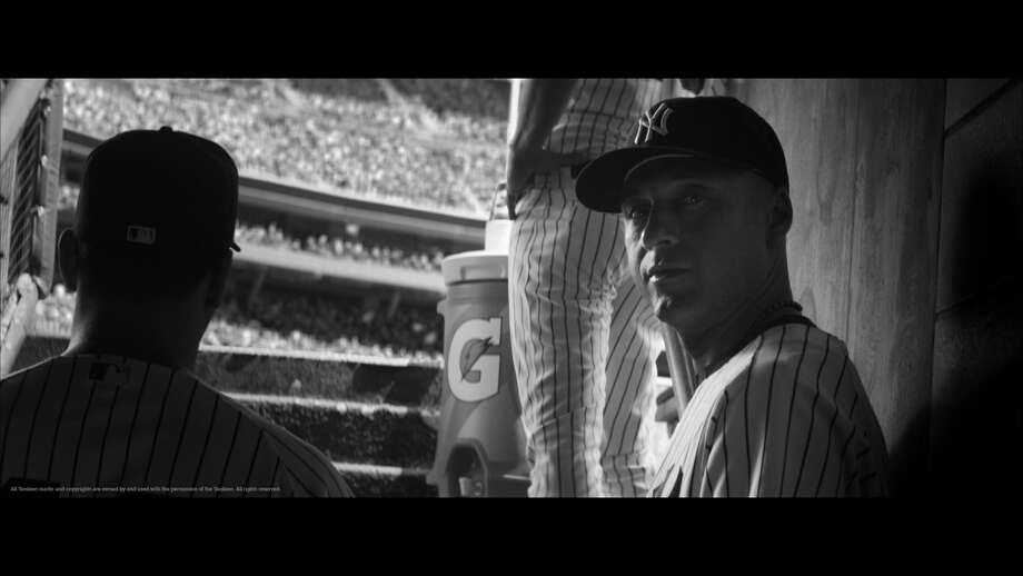 """This undated image provided by TBWA\Worldwide shows Derek Jeter in a Gatorade advertisement. Jeter is going out his way. On the first day of the final regular-season homestand for the New York Yankees' captain, Gatorade began running a 90-second advertisement showing Jeter walking around the Bronx neighborhood outside Yankee Stadium, Thursday, Sept. 18, 2014. Shot in black and white, the ad is accompanied by Frank Sinatra's recording of """"My Way."""" (AP Photo/TBWA\Worldwide) ORG XMIT: NY174 / TBWA\Worldwide"""