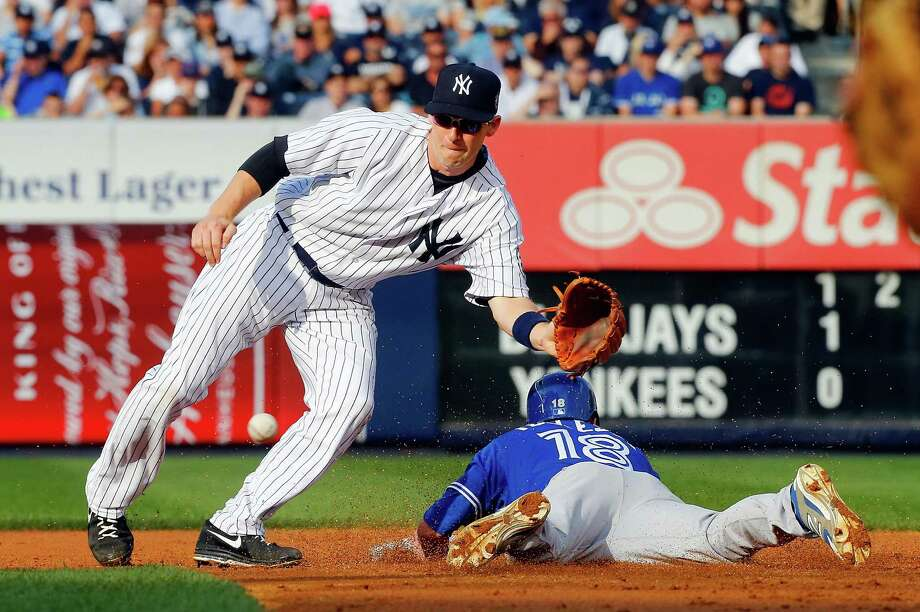 NEW YORK, NY - SEPTEMBER 20:  Steve Tolleson #18 of the Toronto Blue Jays steals second base in the second inning ahead of the throw to Stephen Drew #33 of the New York Yankees at Yankee Stadium on September 20, 2014 in the Bronx borough of New York City.  (Photo by Jim McIsaac/Getty Images) ORG XMIT: 477590257 Photo: Jim McIsaac / 2014 Getty Images