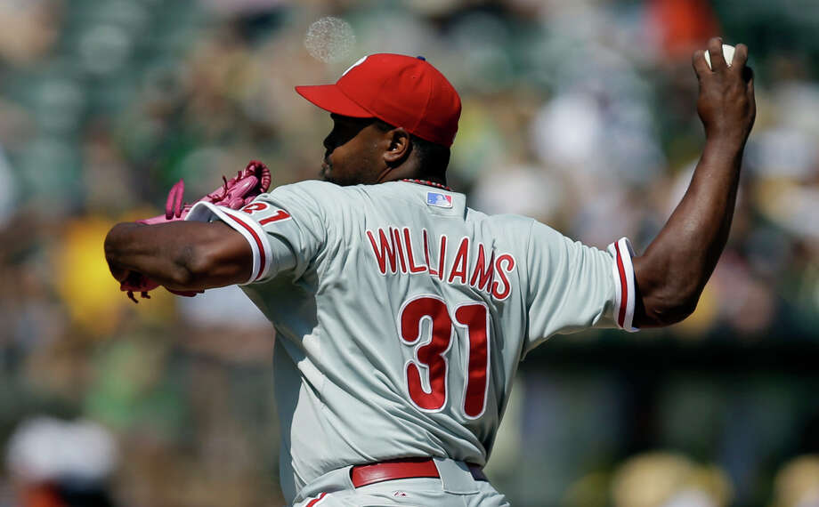 The Phillies' Jerome Williams held the Athletics scoreless over seven innings to earn a win over Oakland with his third team this season. He also defeated the A's with the Astros and Rangers. Photo: Ben Margot, STF / AP