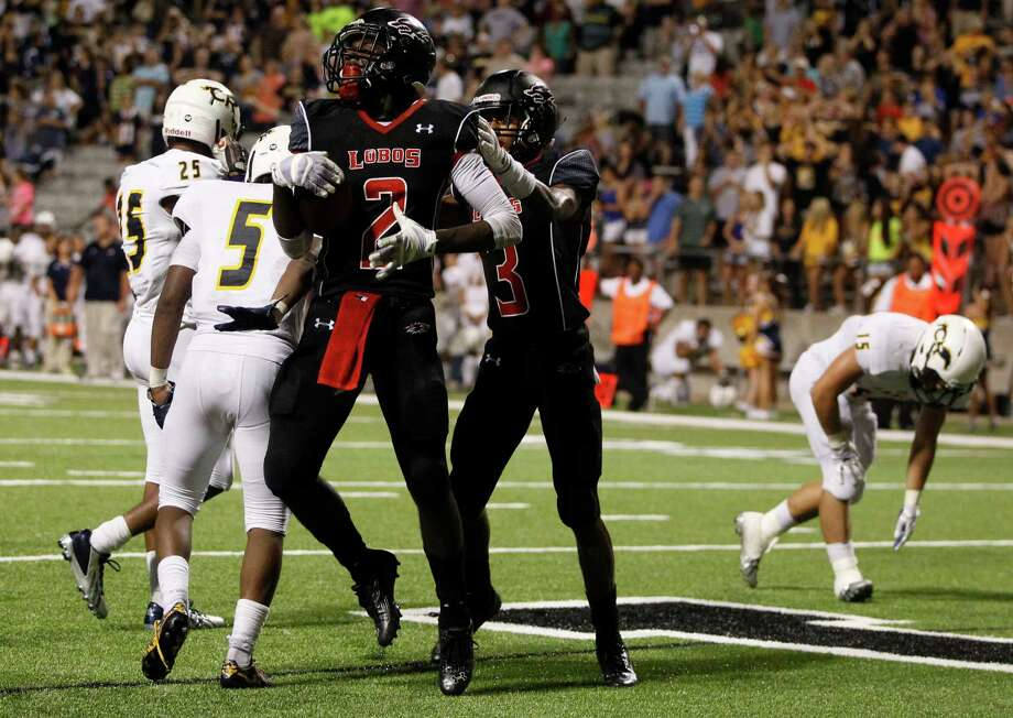 Langham Creek's Quartney Davis (2) celebrates after scoring the winning touchdown in a District 17-6A victory over Cypress Ranch at the Berry Center. Photo: J. Patric Schneider, Freelance / © 2014 Houston Chronicle