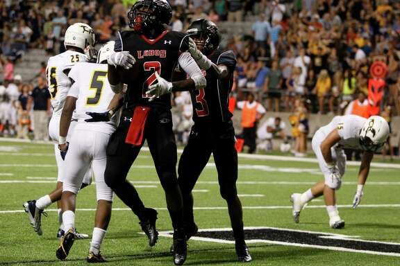 Langham Creek's Quartney Davis (2) celebrates after scoring the winning touchdown in a District 17-6A victory over Cypress Ranch at the Berry Center.