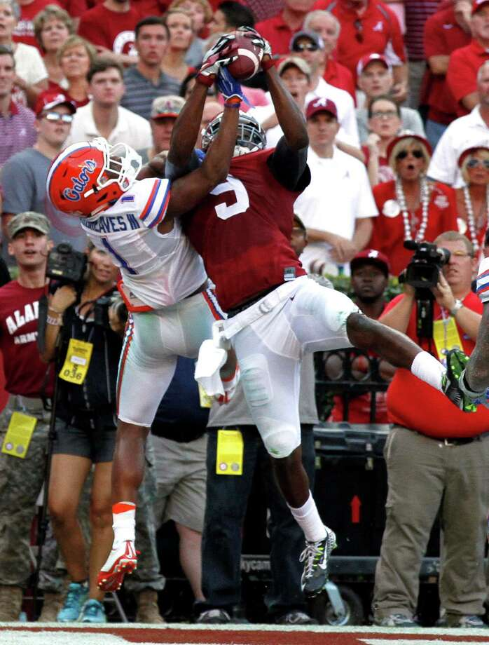 Alabama wide receiver Amari Cooper (9) catches a pass over the top of Florida defensive back Vernon Hargreaves III (1) for a touchdown during the second half of an NCAA college football game on Saturday, Sept. 20, 2014, in Tuscaloosa, Ala. (AP Photo/Butch Dill) ORG XMIT: ALBD111 Photo: Butch Dill / FR111446 AP
