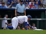 Kansas City Royals catcher Salvador Perez (13) crawls back to third base after over running it during the sixth inning of their baseball game against the Detroit Tigers, Saturday, Sept. 20, 2014, in Kansas City, Mo. Later in the inning he'd be called out on a base-running error.  (AP Photo/Reed Hoffmann) ORG XMIT: MORH127