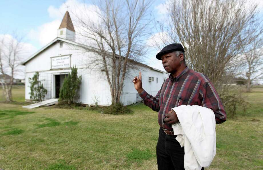 "Pastor David Fisher Sr. says his tiny congregation can't afford to fix the building, but is hamstrung by an ""occupancy deed"" with the owner of the land where the church has been since 1935. Photo: Karen Warren, Staff / © 2013 Houston Chronicle"