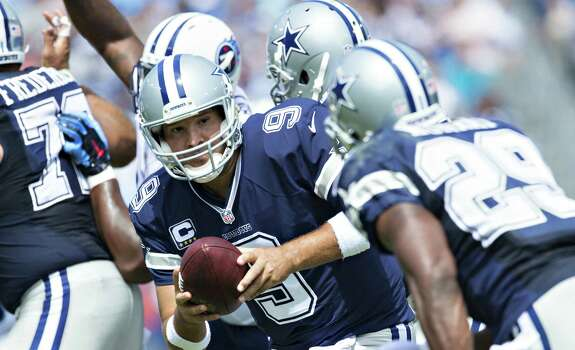 NASHVILLE, TN - SEPTEMBER 14:  Tony Romo #9 makes a hand off to DeMarco Murray #29 of the Dallas Cowboys runs the ball against the Tennessee Titans  at LP Field on September 14, 2014 in Nashville, Tennessee. Photo: Wesley Hitt, Getty Images / 2014 Getty Images