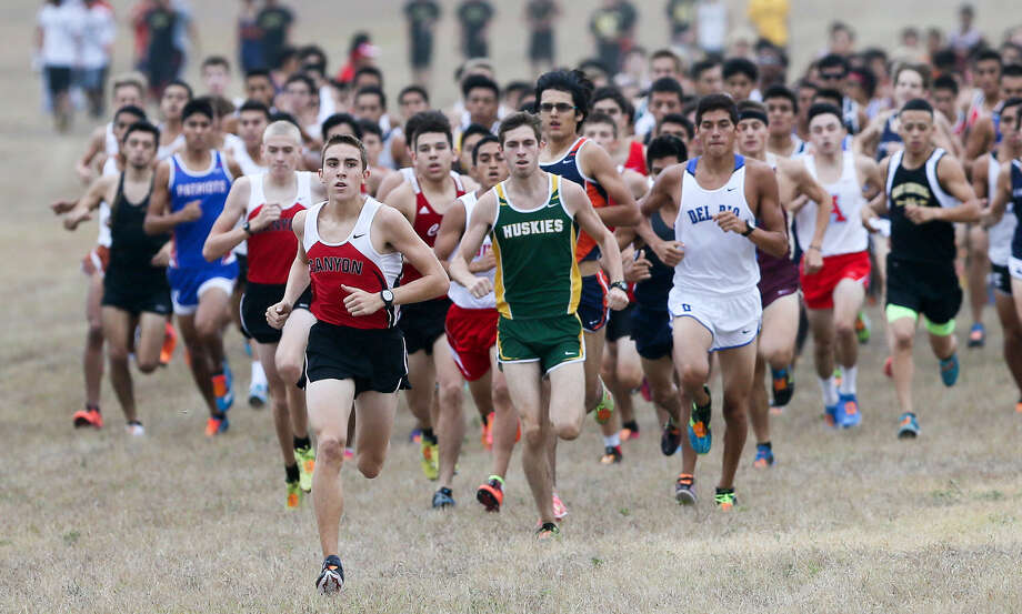 New Braunfels Canyon's Alex Rogers, leading the pack Saturday at UTSA, won the boys Gold Division race in 15:28.3. Photo: Photos By Marvin Pfeiffer / San Antonio Express-News / Express-News 2014