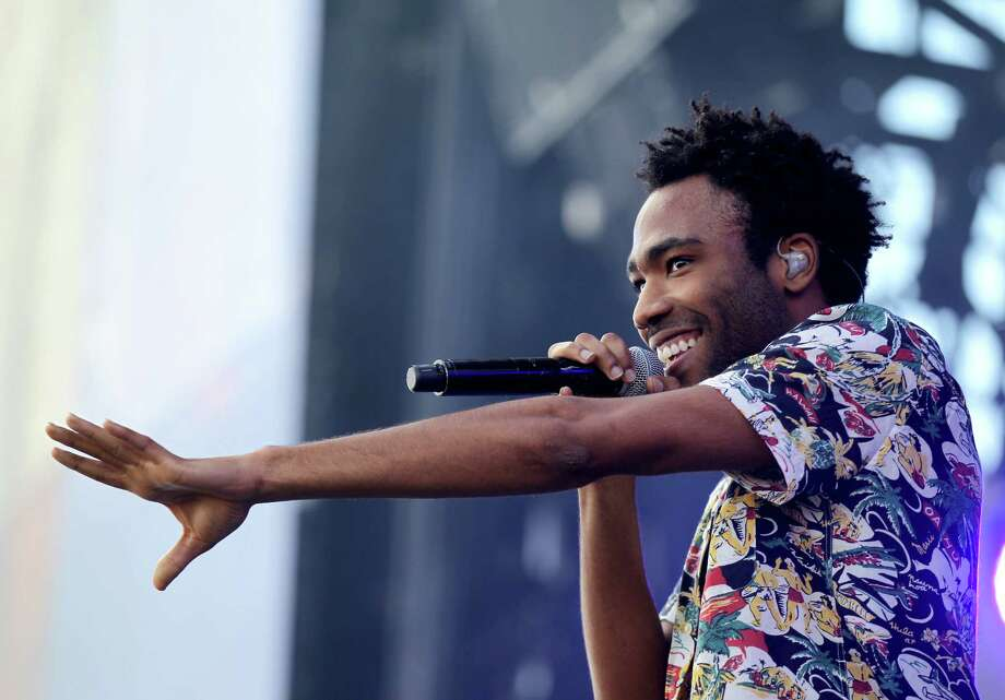 Actor/rapper Donald Glover (aka Childish Gambino) performs onstage during the 2014 iHeartRadio Music Festival Village on September 20, 2014 in Las Vegas, Nevada. Photo: Isaac Brekken, Getty Images For Clear Channel / 2014 Getty Images