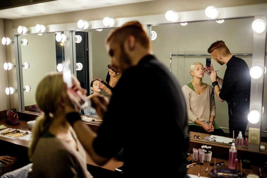 Away from the crowds, models and makeup artists spend time together in front of a bank of lit mirrors at the third annual Downtown Seattle Rocks the Runway fashion show Saturday, September 20, 2014, at The Paramount Theatre in Seattle, Washington. Delta Air Lines and KeyBank presented the red carpet affair. Photo: JORDAN STEAD, SEATTLEPI.COM / SEATTLEPI.COM