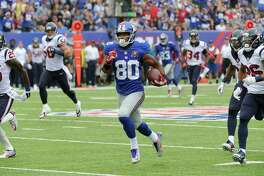 New York Giants wide receiver Victor Cruz (80) takes the ball up field for a first down against the Houston Texans in the second quarter of an NFL football game, Sunday, Sept. 21, 2014, in East Rutherford, N.J. (AP Photo/Bill Kostroun)