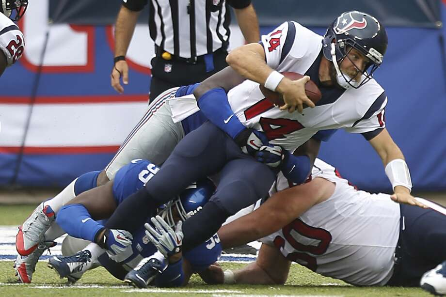 Houston Texans quarterback Ryan Fitzpatrick (14) is sacked by New York Giants defensive tackle Johnathan Hankins (95) during the second quarter of an NFL football game at MetLife Stadium on Sunday, Sept. 21, 2014, in East Rutherford, N.J. ( Brett Coomer / Houston Chronicle ) Photo: Brett Coomer, Houston Chronicle