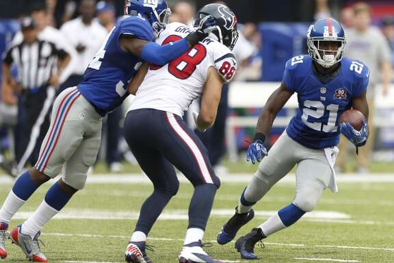 New York Giants cornerback Dominique Rodgers-Cromartie (21) cuts back across the field past Houston Texans tight end Garrett Graham (88) while returning an interception of a Ryan Fitzpatrick pass during the fourth quarter of an NFL football game at MetLife Stadium on Sunday, Sept. 21, 2014, in East Rutherford, N.J. ( Brett Coomer / Houston Chronicle )
