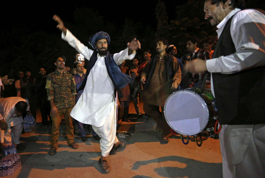 Backers of Ashraf Ghani Ahmadzai celebrate his victory with music and dancing near his house in Kabul. Photo: Rahmat Gul, STR / Associated Press / AP