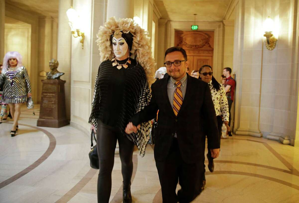 San Francisco Supervisor David Campos walks with drag queen Sister Roma after a meeting over Facebook's policy requiring people to use their real names. In another move, Campos, on Tuesday, will officially introduce legislation that would require city contractors with at least 20 employees to report annually - and confidentially - their employees' pay to the city's Human Rights Commission.