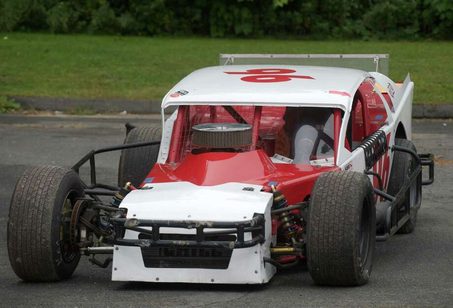 A modified stock car waits to be moved into place for the 13th annual Southern New York Racing Association reunion, held at The Danbury Police Activities League Center, in Danbury, Conn, on Sunday, September 21, 2014. Photo: H John Voorhees III / The News-Times Staff Photographer