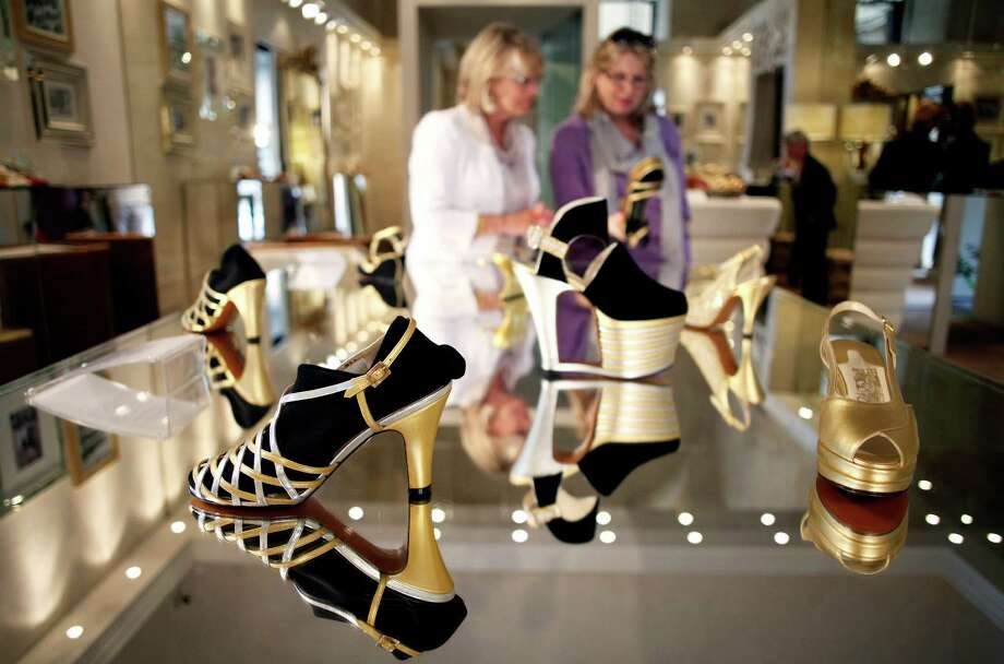Luxury goods - such as these Salvatore Ferragamo SpA shoes - are increasingly out of reach for a middle class with lagging pay raises. ( Bloomberg ) Photo: Alessia Pierdomenico / Copyright 2012 Bloomberg Finance LP