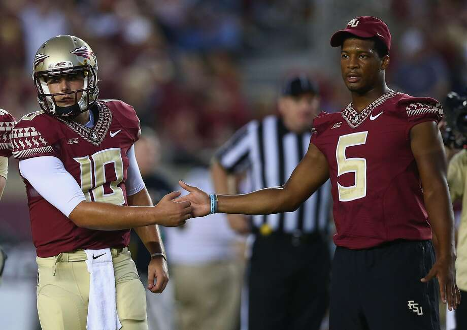 TALLAHASSEE, FL - SEPTEMBER 20:  Jameis Winston #5 of the Florida State Seminoles shakes hands with Sean Maguire #10 on the field during pregame against the Clemson Tigers at Doak Campbell Stadium on September 20, 2014 in Tallahassee, Florida.  (Photo by Ronald Martinez/Getty Images) Photo: Ronald Martinez, Getty Images