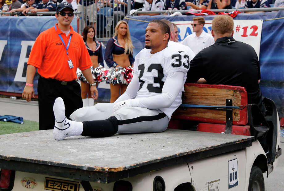 Raiders strong safety Tyvon Branch is taken off the field after breaking his foot in the second half of Oakland's loss. Photo: Elise Amendola, STF / Associated Press / AP