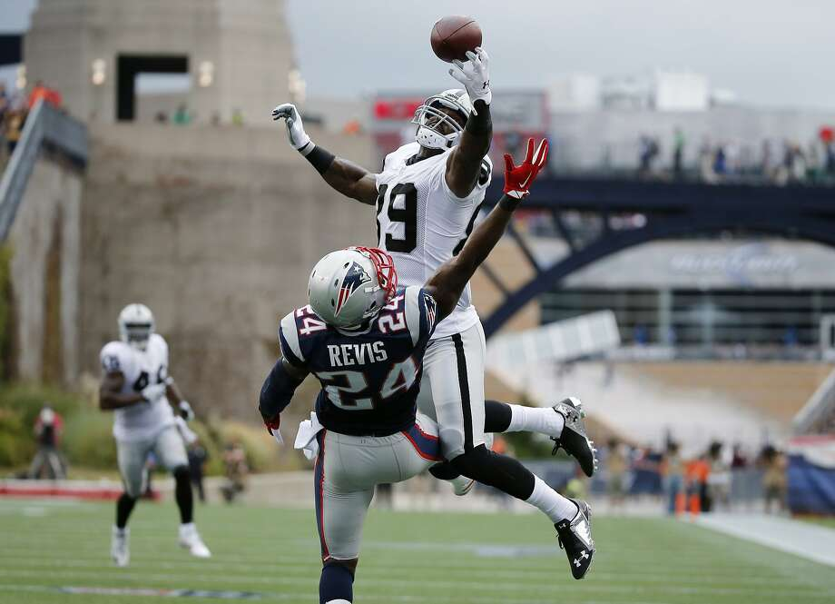 New England Patriots cornerback Darrelle Revis (24) breaks up a pass to Oakland Raiders wide receiver James Jones (89) in the end zone in the fourth quarter of an NFL football game Sunday, Sept. 21, 2014, in Foxborough, Mass. (AP Photo/Elise Amendola) Photo: Elise Amendola, Associated Press